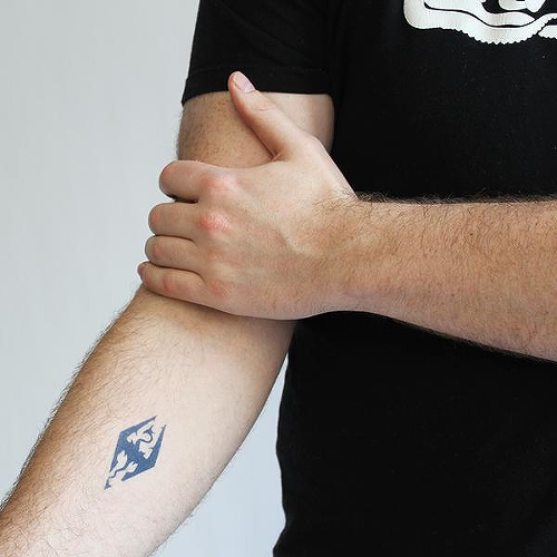 Akatosh by Miguel Romero is a Gaming & Fandom temporary tattoo from inkbox - 0