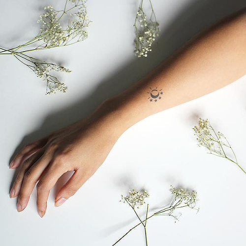 Esmara by Tyler Rehberg is a Minimal temporary tattoo from inkbox - 0