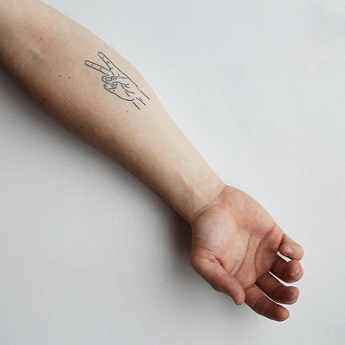 Handsy Hippie by Curt Montgomery is a  temporary tattoo from inkbox - 0