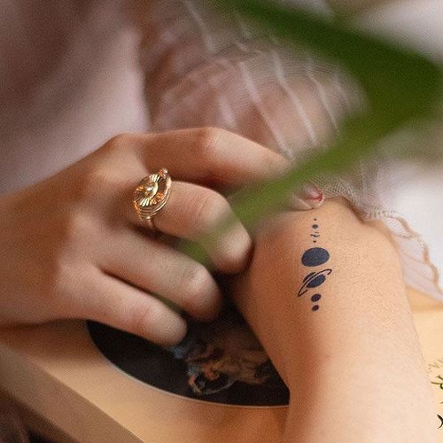 Orrey by inkbox is a Space temporary tattoo from inkbox - 1