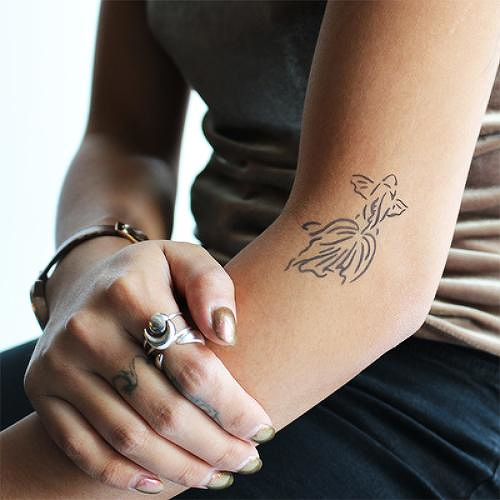 Plakat by Kristine Vodon is a  temporary tattoo from inkbox - 0