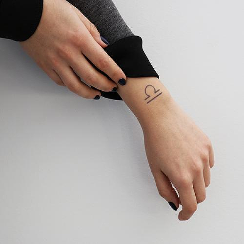 The Scales by Nikki Di Biasio is a Astrology temporary tattoo from inkbox - 0