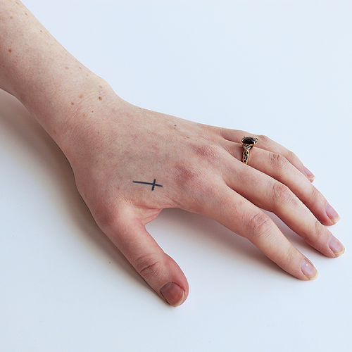 Traicere by Melina is a Minimal temporary tattoo from inkbox - 2